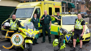 London Ambulance truck, car, motorbike and bicyle