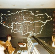 old image of control room with map of London in background
