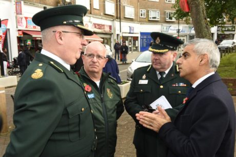 Paul Gates, Consultant Paramedic, Terry Healy, Paramedic Team Leader, and Liam Lehane, Assistant Director of Operations, speak to Mayor Sadiq Khan at the memorial