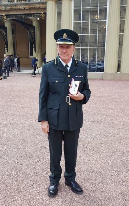 Paul Smith receives the Queen's Ambulance Service Medal