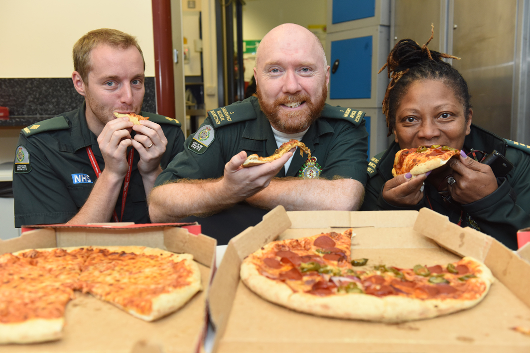 Staff at our Waterloo control room tuck into pizza kindly bought by a documentary fan