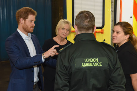 Prince harry with cycle response paramedic Susanna Trow and Assistant Director of Operations Peter Rhodes