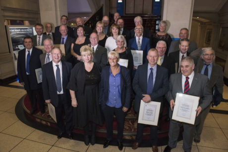 Staff who have retired in the last year celebrate their service
