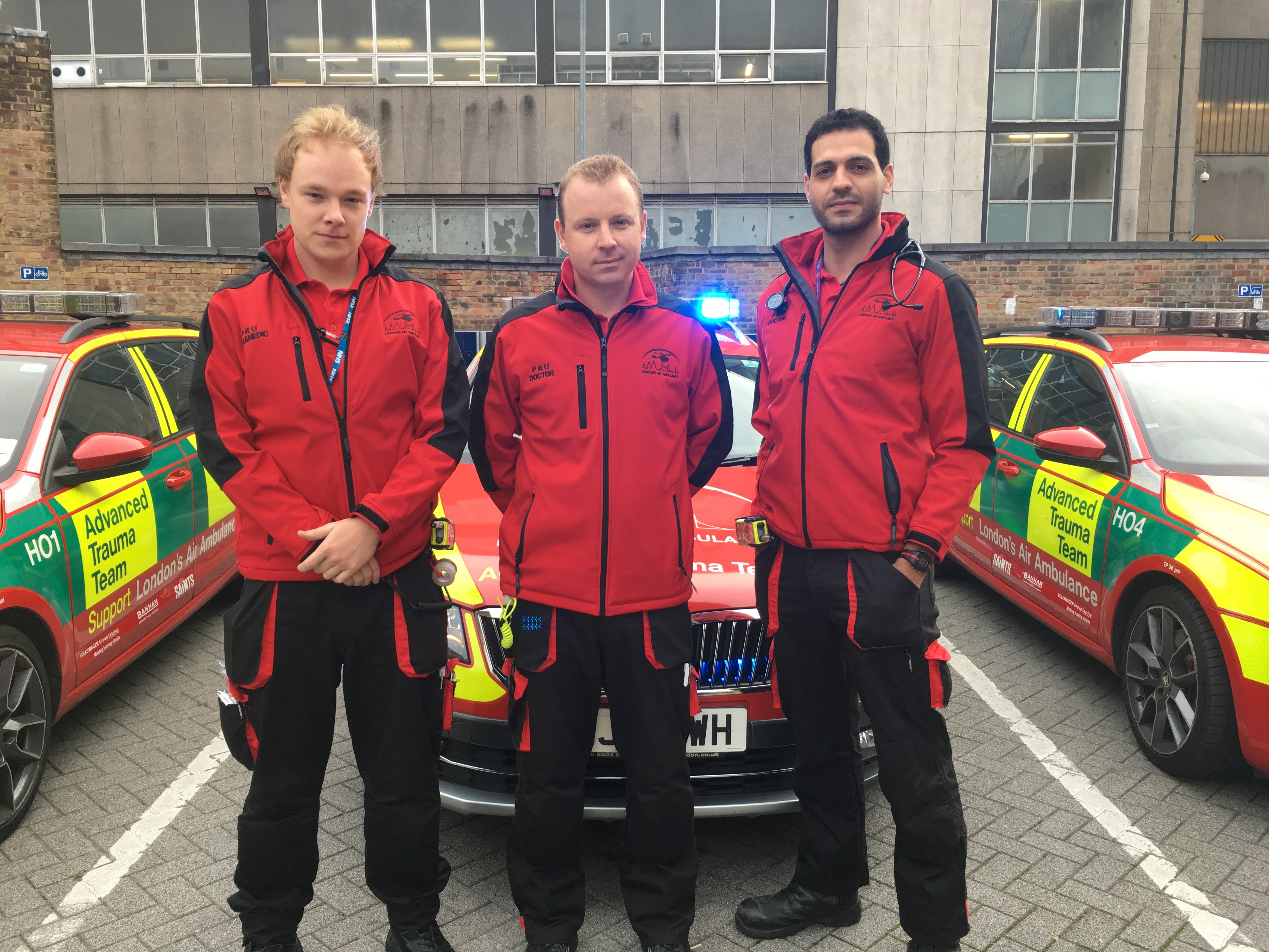Crew from the Physician Response Unit in front of car