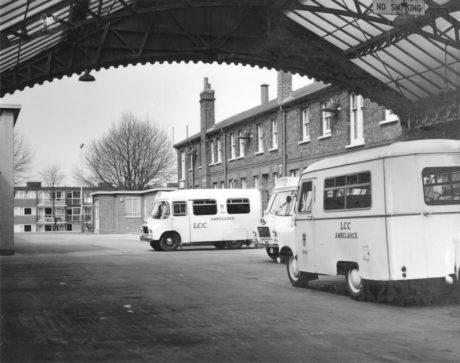 Nineteen sixties ambulances parked