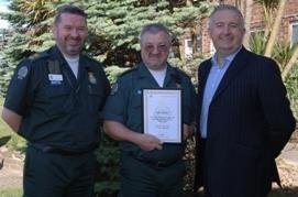 John Gilburt receiving long service award
