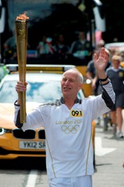 Jim Mundy carried the Olympic torch in Redhill