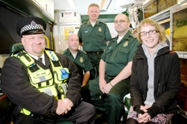 Cardiac arrest survivor Mary Cook with her lifesavers