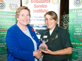 Rebecca receives award from Jacqui Lait MP