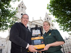 Clerk of the Works Martin Fletcher and Paramedic Claire Adams with a defibrillator
