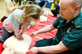Learning CPR at the Islington community health fair