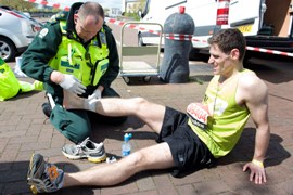 Staff treat a runner at the London Marathon 2012