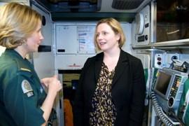 Paramedic Lorraine Bint with MP Mary Macleod in an ambulance