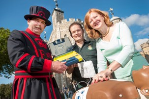 Deputy Mayor Victoria Borwick and a Beefeater learning how to use a defib