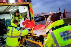 Abdul Malik, first Libyan patient, being put into ambulance by paramedics