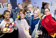 Staff holding a clothes swap for charity