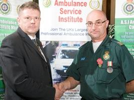 Frank Samaras receives award from Michael Pearce