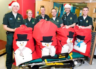 London Ambulance Service medics distribute Christmas presents to children in hospitals