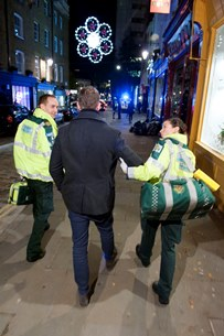 Ambulance staff help a patient at Christmas time