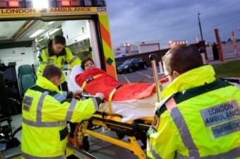 Abdul Malik being put into ambulance by london ambulance staff
