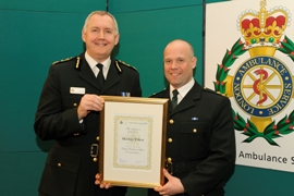 Chief Executive Peter Bradley presenting Martyn Tillett with the Chief Ambulance Officer's Commendation