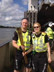 Paramedic Michael Casizzi and Emergency Medical Technician Nicola Czwartos with Olympic torch