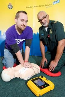 Paul Cowling using a defibrillator