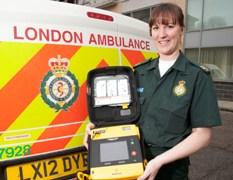 Sam Wilcox with a defibrillator