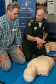 Paramedic Norman Abbot teaching basic life support
