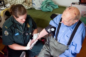 A paramedic treating a patient