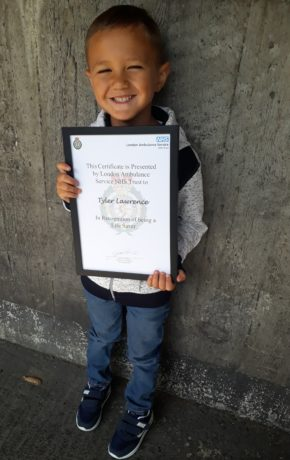 Tyler Lawrence with his certificate