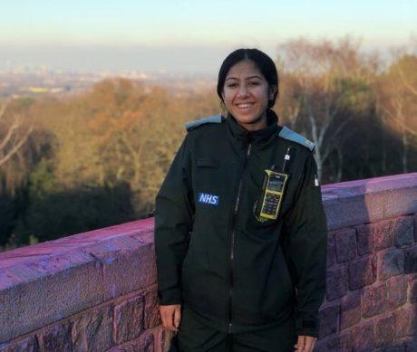 Emergency responder in uniform smiles