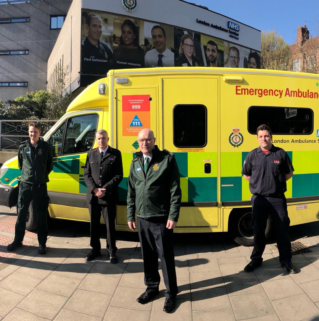 Paramedic, LFB Commissioner, LAS Chief Executive and firefighter stood in front of ambulance