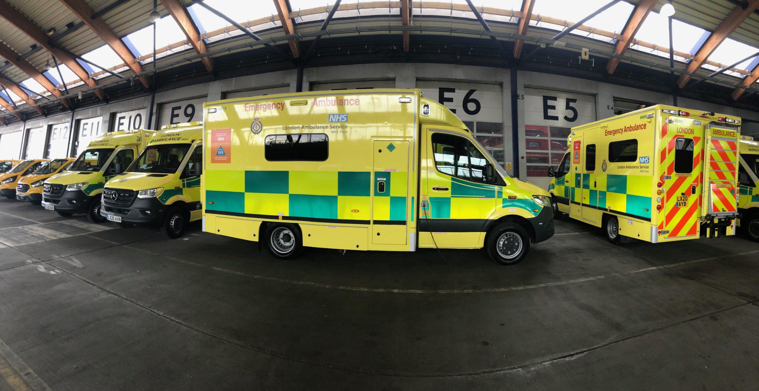 row of new ambulances in garage