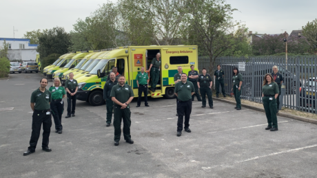 A group of people stood - at a safe distance from one another - in front of a row of ambulances. Some are in the CFR uniform and others are in LAS uniform