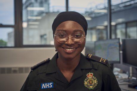 Zeynab in uniform smiling to camera