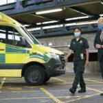 Prime Minister walks past ambulance alongside female medic