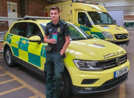 Thomas stood in front of an ambulance car and ambulance