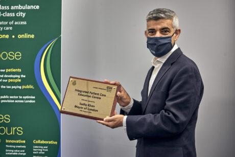 Mayor holding plaque