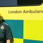 Hina in Service uniform next to ambulance