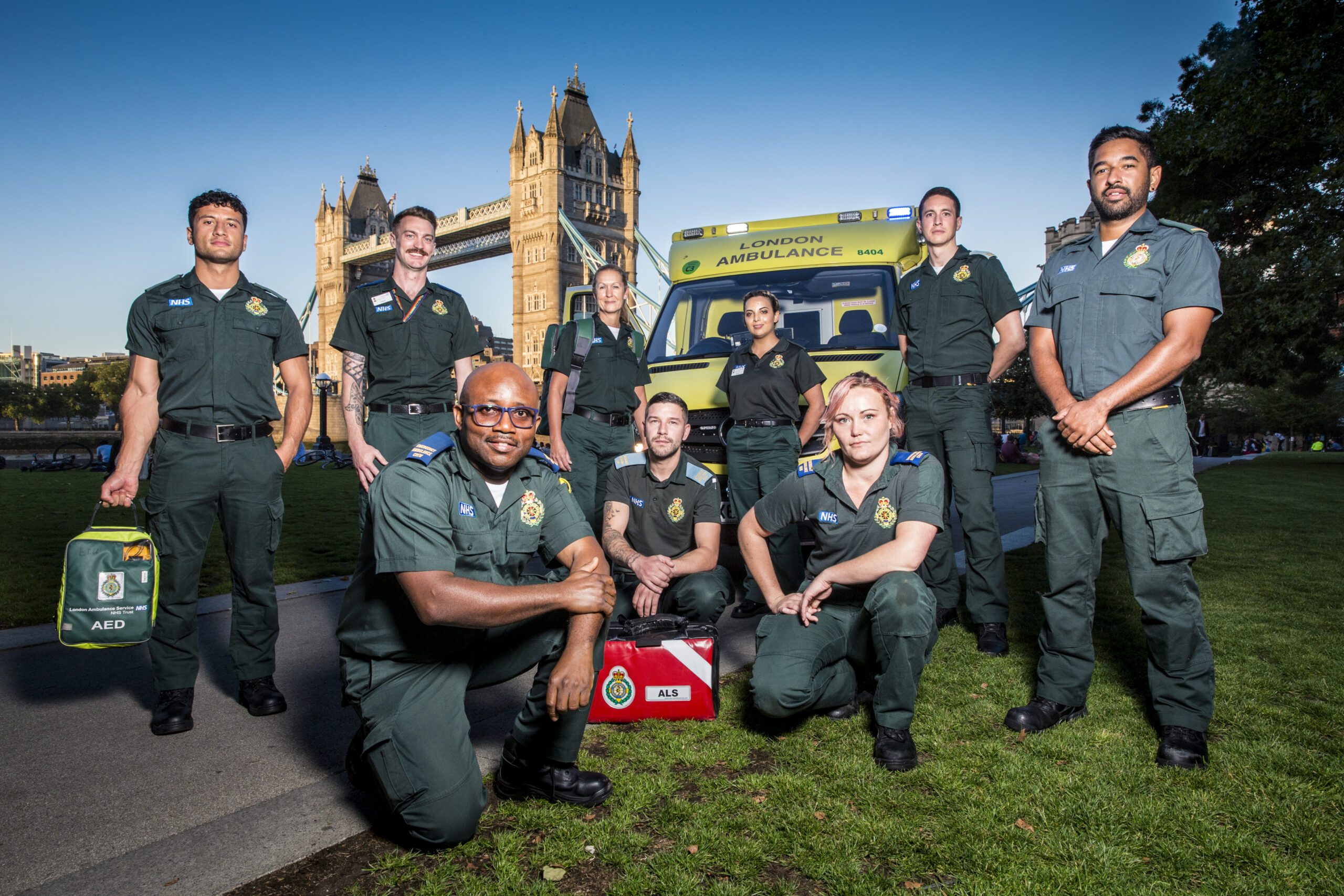Group of ambulance staff in front of ambulance and Tower Bridge