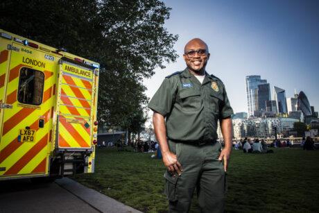 Femi stood next to rear of ambulance