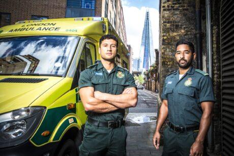 Masih and Johann stood next to an ambulance