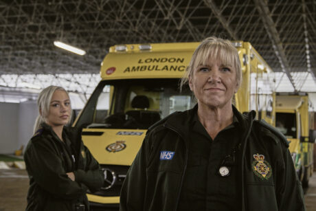 Maisie and Nicola stood in front of an ambulance