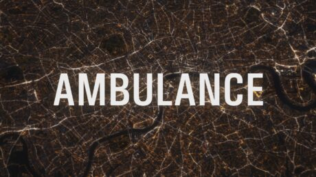 Ambulance documentary opening titles show the word Ambulance over a night aerial shot of central london