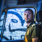 Stuart in an ambulance cab