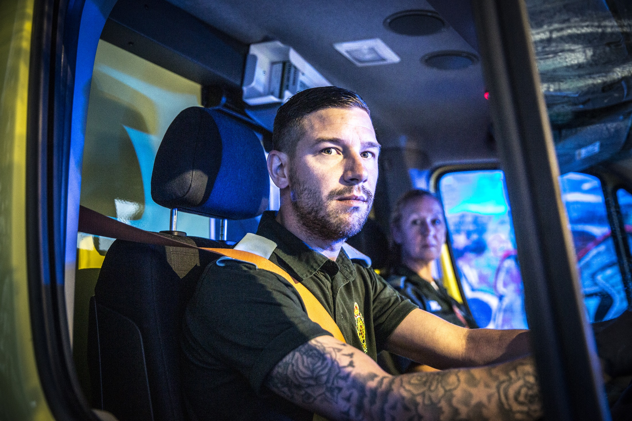 Stuart and Rachel in the cab of an ambulance