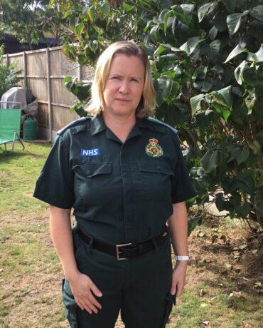 Tracy in her LAS uniform in a garden