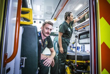 Adam and Orani in back of an ambulance