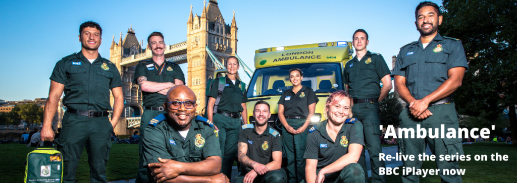 Some of the stars of the sixth series of the Ambulance documentary stood together with Tower Bridge and an ambulance in the background and the caption Re live the series on the BBC iPlayer now